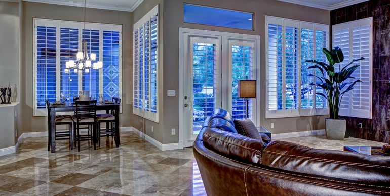 Gainesville great room with plantation shutters and tile floor.